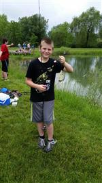 Fishing club member with his catch